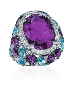 CELLINI Jewelers- Amethyst, Blue Topaz and Diamond Ring - Oval-shaped Amethyst is surrounded by round brilliant Diamonds, Amethyst, blue Topaz and Diamond shank, set in 18-karat white Gold Diamond weight: approximately 0.74 carats total. Amethyst weight: approximately 12.24 carats total. Blue Topaz weight: approximately 5.02 carats total. ☆$8,750.00☆