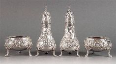 TWO SETS OF KIRK & SON REPOUSSE STERLING SILVER SALT CELLARS AND PEPPER SHAKERS