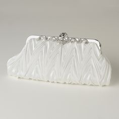 This beautifully pleated cream satin evening bag with decorative silver  frame accented with rhinestones is absolutely stunning.  Rhinestone  encrusted clasp with side pocket inside and chain that can be used with  or without to make into an over the shoulder bag.  This evening bag is  classy and timeless perfect for an evening outSize: 11 Length  6 Height 2 Width
