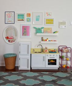 Step Right Up To The Wall O' Fun   Young House Love Add shelves above toy kitchen to store extra food.