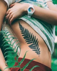 Fern leaf on the right side ribcage.