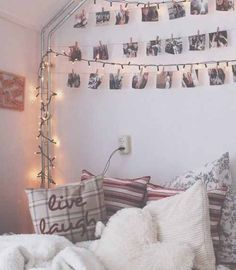 Tumbler bedrooms all the way, I love this style how the pictures are hanging from t wall on a wire