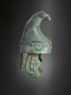Roman bronze cavalry helmet in the Phrygian style, terminating in an eagle's head, decorated in an all over scale pattern with a warrior on the cheek-pieces and winged victories on the brim. Historical Artifacts, Ancient Artifacts, Elmo, Bronze, Ancient Armor, Roman Art, Ancient Romans, Ancient Civilizations, Roman Empire