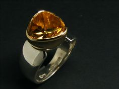 Stunning Citrine liquid flower set in9ct gold rub setting with a asymmetrical sterling silver band