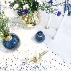 ferm LIVING Splash Tablecloth in blue: http://www.fermliving.com/webshop/shop/kitchen/tablecloths-and-napkins/splash-table-cloth-blue-240-cm.aspx