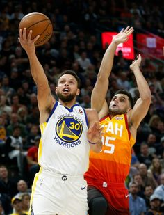 Golden State Warriors guard Stephen Curry (30) lays the ball up as Utah Jazz guard Raul Neto, right, defends in the first half during an NBA basketball game Tuesday, Jan. 30, 2018, in Salt Lake City. (AP Photo/Rick Bowmer)