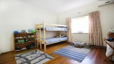 Child's room with wood floors, built-in cupboards, and AC Built In Cupboards, Child's Room, Classic House, Property For Sale, Floors, Kids Room, Toddler Bed, Bedroom Decor, Real Estate