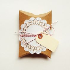 kraft box + doily + bakers twine + manila hang tag