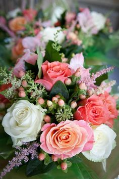 Vintage style Hand-tied bridesmaids bouquets of Miss Piggy Roses, Avalanche Roses, Pink Pop Roses, Coral Gladioli, Coral Hypericum, Ivory Astilbe and Berried Ivy.
