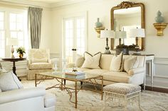 Neutral with gold and turquoise ~ love the coffee table; it helps the room not take itself too seriously