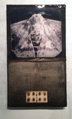 Trove 1036 (they will lead us to light) 24x30 photo with wax, resin, and found materials