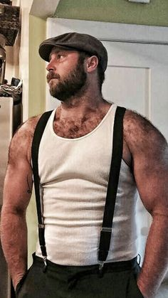 Handsome Hairy Bear man in tank tee and suspenders