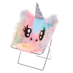 Pastel Rainbow Unicorn Phone Holder | Your phone can relax in style with this pretty pastel coloured unicorn phone holder. This phone holder is shaped like a folding chair but it features a unicorn face and magical horn.