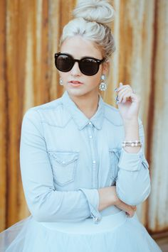 messy bun and statement earrings