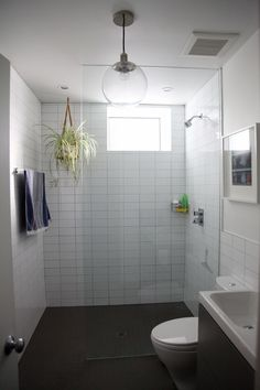 Stacked bond tile, looks to be bigger than 3x6. Very clean and modern. Glass?  Love, love love but where would i put the tub?