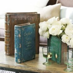 "Vintage Book Vases (""World Atlas Encyclopedia,"" ""Corsaire,"" and ""English Fairy Tales"") by Ballard Designs."
