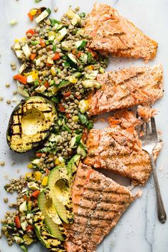 Premium Copper River King Salmon grilled with salt and pepper and served with a green lentil and grilled vegetable salad. #copperriversalmon