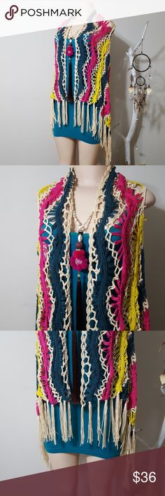 NWT! NEW! DOUBLE ZERO COLORFUL CROCHET VEST! NWT! NEW! DOUBLE ZERO COLORFUL CROCHET VEST WITH FRINGE! Nicely made. Beautiful color pallet in these vibrant colors. High low cut. Fringe bottom. NEW WITH TAGS! 55%acrylic. 45%cotton. Double Zero Tops Blouses