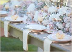 Love the flowers and table settings here from  Couture Events