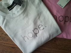 WOMENS WHITE DKNY JEANS RHINESTONE HOPE CAP SLEEVE T-SHIRT. L LARGE. NWT. $16.00.