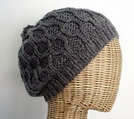 This hat was inspired by the hat that Emily Deschanel wore in the Bones episode, The Blackout in the Blizzard. It is a slouchy tam with a pom pom, and fully finished crown decreases (to allow knitters to omit the pom pom if it's not their thing).