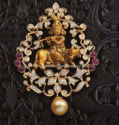 Attractive diamond pendant in close setting design featuring divine figure of Lord Krishna adorned with 3 spinel rubies on both sides and a single south sea pearl drop. Antique Jewellery Designs, Gold Jewellery Design, Diamond Jewellery, Antique Jewelry, Gold Temple Jewellery, Gold Jewelry, Gold Necklace, Pendant Jewelry, Beaded Jewelry