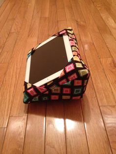 Black with Multi-colored Squares - iWedge iPad Pillow Cushion Stand. $35.00, via Etsy. iPad pillow - image source via Google Search. (Cushion / rest / stand for Tablets / Kindles etc.) *** I bet you could easily DIY / sew one yourself :) ***