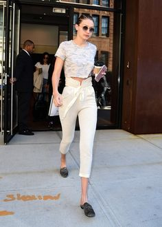 Instead of jeans, Gigi added interest to a t-shirt with high-waisted trousers.		              Image Source:...