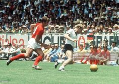 World Cup Quarter-Final, 1970, Leon, Mexico, England 2 v West Germany 3, 14th June, 1970, England's Geoff Hurst chases a West German player for the aball during the match