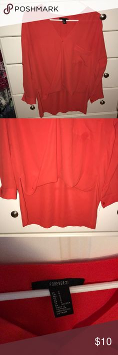 Forever 21 high low cross-cross blouse size Small Women's blouse from forever 21 size small. It is a high-low too with a Criss-Cross front that has a snap to stay crossed over. Has been sitting in my closet for years never worn. No stains rips or tears. Questions comments offers welcome Forever 21 Tops Blouses
