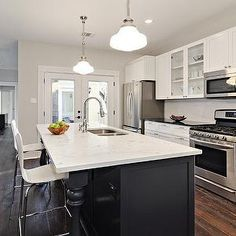 Benjamin Moore Moonshine paint color for kitchen/dinning room.  BM Simply White for ceiling/trim.