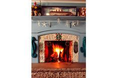 Christie Brinkley's Fireplace she designed-cute!