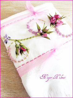 Idea:- Make a pretty edging for towel, runner or cushion/pillow with ribbons or fabric flowers.