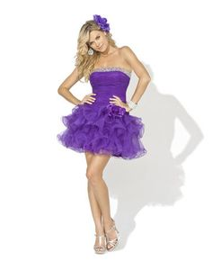 Prom Dress by Blush, style X001. This dress is strapless tulle with a tiered short full skirt. Beading edges the straight neckline.