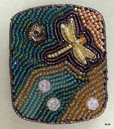 An Altoid Tin covered in seed beads...this will be fun to make!