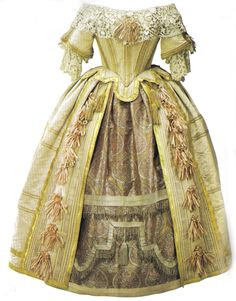 Queen Victoria had this gown commissioned for the Stuart Ball she held in 1851. The dress was designed by Eugenie Lemi but Victoria was heavily involved in the designing of the dress and it was based on the court of Charles II. The dress is covered in seed pearls and is made of silk. It also features gold, silver and the finest Irish lace