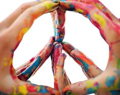 peace sign with paint-covered hands