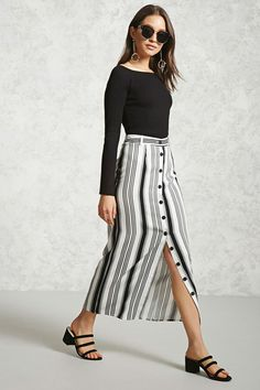 A woven maxi skirt featuring a stripe pattern, button-front, and belt loops.