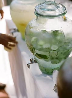 cucumber + lemon water in dispensers..I want these for all the time but definately at the wedding