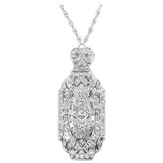 """Art Deco Diamond Platinum Pendant Necklace. This Platinum Diamond Deco Necklace has 94 Round and Baguette Diamonds=~2.75Ctw. (G-I, VS-SI). The upper section in hinged. The Pendant is hanging on an 18K WG wire marquise scroll vintage style link chain 15"""". Pendant has beautiful crisp details with milgraining and bright polished finish."""