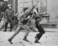 A paratrooper grabs a youth by the hair as he arrests him in Derry on Bloody Sunday.