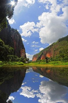 Harau Valley is in West Sumatra in Indonesia. It is an area of natural beauty located halfway between Pekanbaru and Bukitinggi. Rice fields are dwarfed by cliffs.