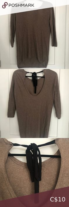 Babaton Tie Back Top Used condition but very stylish for the fall season. Im a size small and this top fits perfect. Aritzia Tops Coral Blouse, Tie Blouse, Sleeveless Blouse, Black Lace Tank Top, Oversized Flannel, Muscle Tank Tops, Grey Zip Ups, Light Wash Jeans, Zip Up Sweater