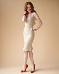Spice up a tan dress with punch red pumps for your wedding rehearsal dinner
