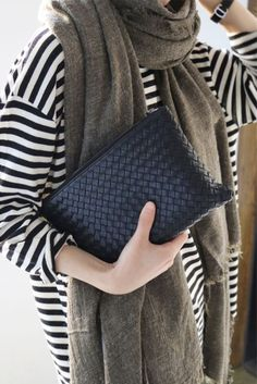 Black leather woven clutch — maxing textures and patterns.
