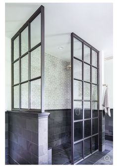 Black framed 3 sided glass shower enclosure with 1/2 wall. This could work.