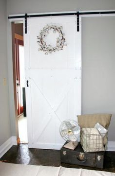 DIY Barn Door and Hardware for around $80!   Do It Yourself Home Projects from Ana White