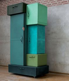 Fun turquoise and green lockers and storage boxes -  Maarten de Ceulear