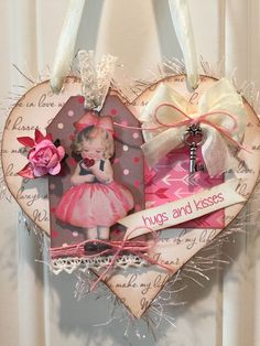 Hanging Valentine heart made from a vintage image of a little girl holding a heart by Ellen Clapsaddle.