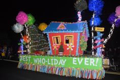 Lessard Builders' float has a Dr. Seuss theme with the Grinch not far away from Whoville. The float took first-place honors in the commercial float division. BY RON MACARTHUR